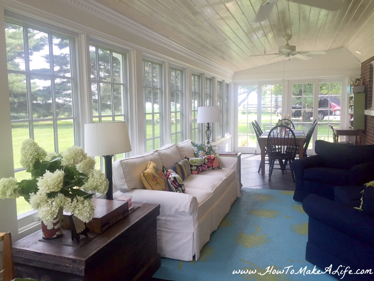 Beautiful southern porch with walls of windows.